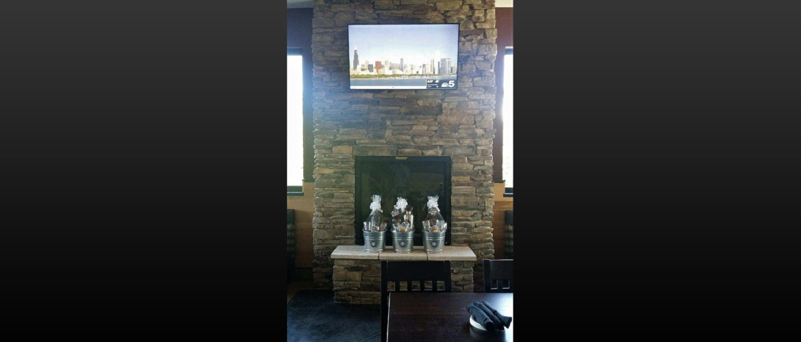 Granite-City-Brewery-New-Construction-Stone-Fireplace.jpg