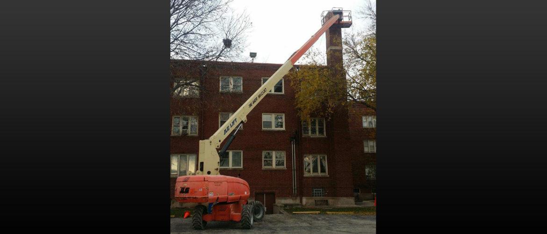 Condo-Chimney-Repair-using-boom-lift.jpg